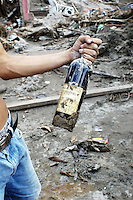 un-opened wine bottle salvaged from the debris left by huricane stan.  Miguel de la Madrid neighbourhood, Tapachula Chiapas