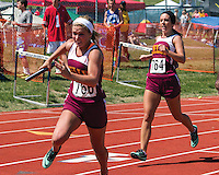 Kelly's Taylor Lasater watches on as McKynlee Neumeyer runs with the baton in the 4x100 relay prelims Friday. Kelly advanced to Saturday's final where they placed 3rd in 50.89.