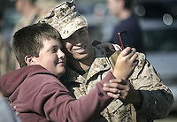 "Peter Janigian takes a picture with his brother, Cpl. Mathew Bueno at Wednesday's homecoming of 2nd Battalion, 9th Marines, 2nd Marine Division after a successful deployment to Iraq""s Al Anbar province, April 22, 2009. Beckley New_2-9Homecoming05"