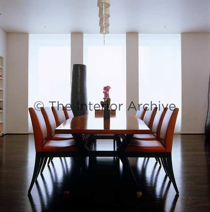 The contemporary dining area is at one end of the long open-plan living space