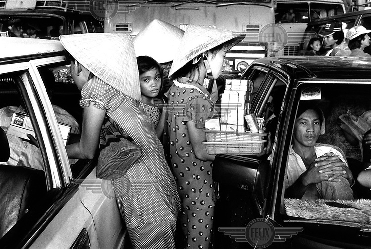 Foto Jan Banning / Panos Pictures,1992..Vietnam. Cigarette vendors on a ferry in the Mekong Delta near My Tho.