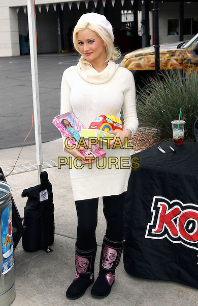 HOLLY MADISON.hosts KOMP 92.3 toy drive for Toys For Tots at Findley Kia, Las Vegas, Nevada, USA, 4th December 2010..full length white cream polo neck jumper sweater dress black leggings pink skull ugg boots uggs hat beret holding toys barbie .CAP/ADM/MJT.© MJT/AdMedia/Capital Pictures.
