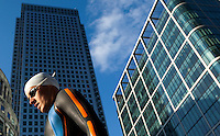 30 JUN 2011 - LONDON, GBR - A competitor walks onto the pontoon for the start of the first men's super sprint elimination round at the GE Canary Wharf Triathlon (PHOTO (C) NIGEL FARROW)