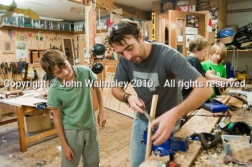 Will Redhead, woodwork teacher, Summerhill School, Leiston, Suffolk. The school was founded by A.S.Neill in 1921 and is run on democratic lines with each person, adult or child, having an equal say.  You don't have to go to lessons if you don't want to but could play all day.  It gets above average GCSE exam results.