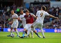 Saturday 15 September 2012<br /> Pictured: Brett Holman of Aston Villa (C) is challenged by Jonathan de Guzman (L) and Miguel Michu of Swansea (R)<br /> Re: Barclay's Premier League, Aston Villa v Swansea City FC at Villa Park, West Midlands, UK.