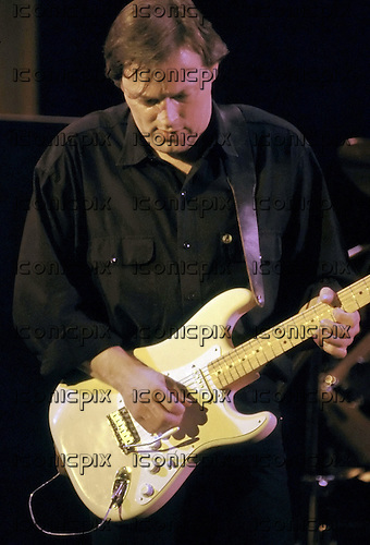 David Gilmour - Pink Floyd guitarist David Gilmour - performing live as a solo artist at the Hammersmith Odeon, London UK - 28 Apr 1984.  Photo credit: George Chin/IconicPix