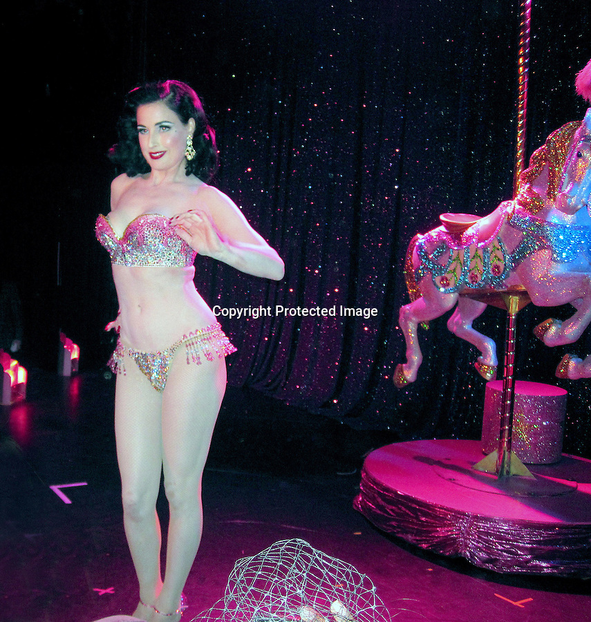 December 13th 2010...Dita Von Teese Burlesque bikini topless strip strip hooray show at the Roxy Theatre In Hollywood California. Dita stripped off her cloths while riding on a horse unicorn carousel holding huge feathers ...AbilityFilms@yahoo.com.805-427-3519.www.AbilityFilms.com.