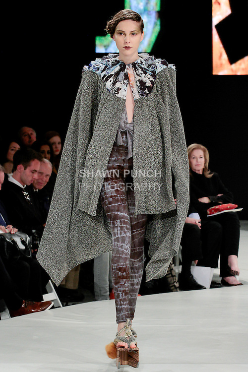 Model walks runway in an outfit by Hannah Ross, during the 2013 Pratt Institute Fashion Show, on April 25, 2013.