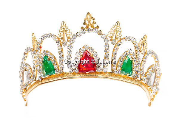 """BNPS.co.uk (01202 558833)<br /> Pic:  Julien's/BNPS<br /> <br /> A gold tone tiara worn by Mae West in her starring role as Catherine II of Russia in the 1944-45 Broadway production of Catherine was Great, est. £800.<br /> <br /> A selection of trailblazing 1930s starlet Mae West's most recognisable film costumes have emerged for sale for £320,000. ($400,000)<br /> <br /> The auction features the actress and screenwriter's gowns, headdresses and tiaras, as well as props from her films and her scripts.<br /> <br /> West, a New York native, was the Marilyn Monroe of her era, earning a 'bad girl' reputation for starring in risque productions.<br /> <br /> She famously coined the phrase: """"When I'm good, I'm very good, but when I'm bad, I'm better."""""""