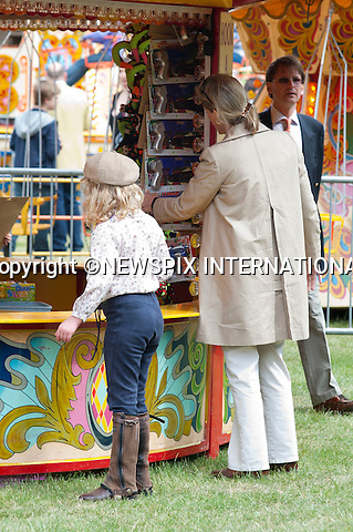 """Prince Edward, Sophie, The Countess of Wessex and their Lady Louise Windsor.enjoy a family day out at the Royal Windsor Horse Show the Wessex Family watched a show in the main arena after which Sophie and Lady Louise went and played on some of the fairground attractions including darts and hook a duck..It was all change from the pomp of the Royal Wedding two weeks ago for the young royal..The Royal Windsor Horse Show 2011, Windsor_14/05/2011.Mandatory Photo Credit: ©Dias/Newspix International..**ALL FEES PAYABLE TO: """"NEWSPIX INTERNATIONAL""""**..PHOTO CREDIT MANDATORY!!: NEWSPIX INTERNATIONAL(Failure to credit will incur a surcharge of 100% of reproduction fees)..IMMEDIATE CONFIRMATION OF USAGE REQUIRED:.Newspix International, 31 Chinnery Hill, Bishop's Stortford, ENGLAND CM23 3PS.Tel:+441279 324672  ; Fax: +441279656877.Mobile:  0777568 1153.e-mail: info@newspixinternational.co.uk"""