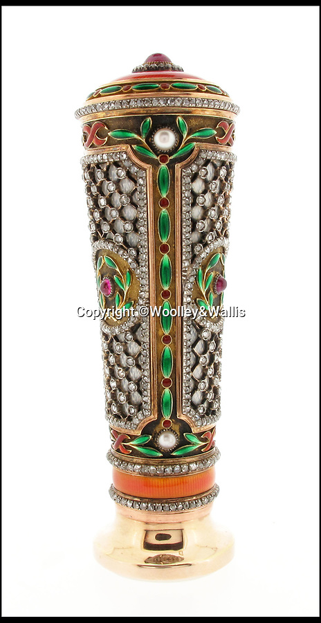BNPS.co.uk (01202)558833Pic: Woolley&Wallis/BNPS<br /> <br /> It never rains but it pours...<br /> <br /> Fabulous Faberge parasol handle sell for a whopping £75,000 - Over 10 times its estimate!