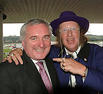 Former Taoiseach Bertie Ahern gots some great tips from controversial and eccentric  racing pundit John McCrirrick when the pair met  at Listowel Races.<br /> Picture by Don MacMonagle