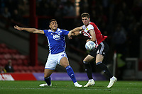 Che Adams of Birmingham City and Brentford's Chris Mepham challenge for the ball during Brentford vs Birmingham City, Sky Bet EFL Championship Football at Griffin Park on 2nd October 2018