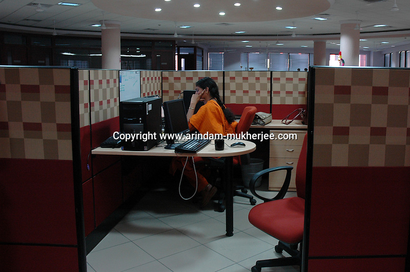 An Indian woman at work in Infosys, Bangalore. Infosys is the largest software company in the country and the head office is in Bangalore, Karnataka, India. Arindam Mukherjee