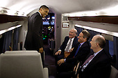 United States President Barack Obama talks with Chief of Staff Bill Daley, U.S. Secretary of the Treasury Timothy Geithner, and National Security Advisor Tom Donilon aboard Marine One en route to Joint Base Andrews, Maryland, November 2, 2011. .Mandatory Credit: Pete Souza - White House via CNP