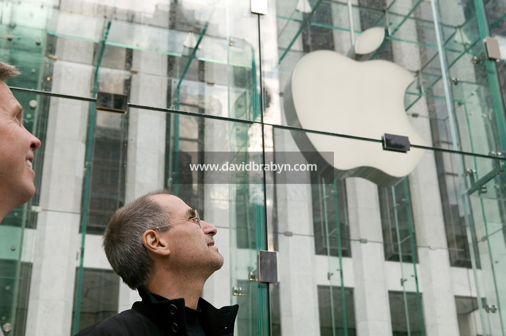 Steve Jobs looking up at the Apple logo on the opening day of the new Apple store on 5th Avenue in New York City, NY, USA, 19 May 2006. Photo Credit: David Brabyn
