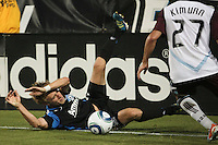 San Jose Earthquakes midfielder Brad Ring (5) slides out of play against Colorado Rapids defender Kosuke Kimura (27) during the Colorado Rapids 2-1 victory over the San Jose Earthquakes at Buck Shaw Stadium in Santa Clara, California.