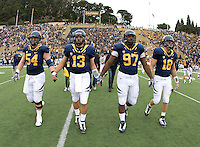 California captains' Chris Guarnero, Kevin Riley, Cameron Jordan and Mike Mohamed walk on the field for coin toss before the game against ASU at Memorial Stadium in Berkeley, California on October 23rd, 2010.  California defeated Arizona State, 50-17.