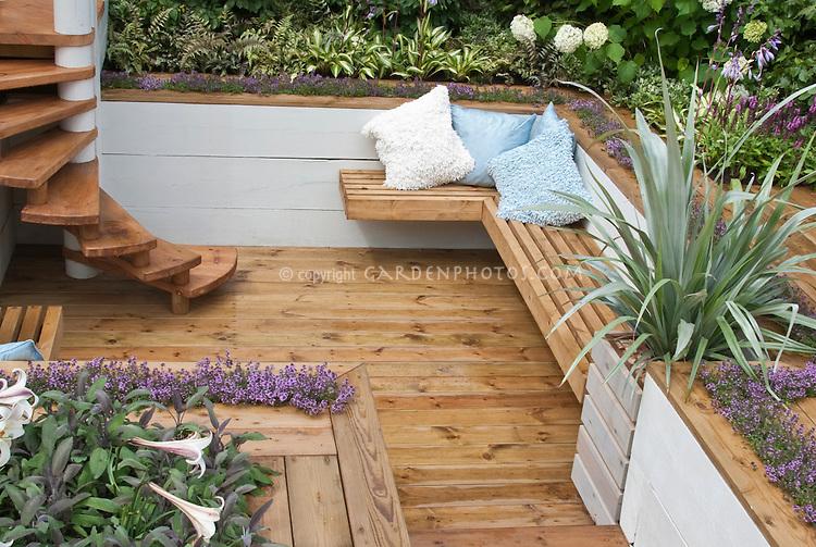 Deck herb garden plant flower stock for Garden ideas decking designs