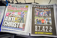 Front pages of the New York newspapers on Friday, October 2, 2015 report on the previous days shooting at Umpqua Community College in Roseburg, Oregon allegedly by Chris Harper-Mercer. The gunmen asked victims if they were Christian and then shot them. (© Richard B. Levine)