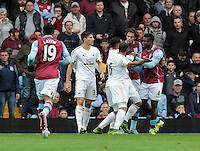 Micah Richards of Aston Villa clashes with Ashley Williams of Swansea City during the Barclays Premier League match between Aston Villa v Swansea City played at the Villa Park Stadium, Birmingham on October 24th 2015