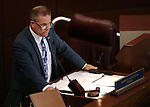 Nevada Lt. Gov. Mark Hutchison works on the Senate floor at the Legislative Building in Carson City, Nev., on Monday, March 23, 2015. <br /> Photo by Cathleen Allison