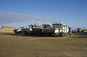 Tractors and large trailable fishing boats, Castlepoint, Masterton, NZ
