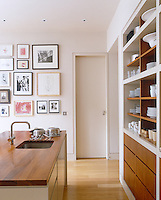 Kitchens can also be family rooms with arrangements of photographs and children's drawings displayed on the walls