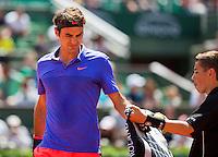 France, Paris , May 24, 2015, Tennis, Roland Garros, ballboy brings towel to Roger Federer (SUI) <br /> Photo: Tennisimages/Henk Koster