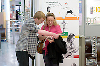 Mother & son discuss options.  Open Day at Kingston College when prospective students and their parents look around.