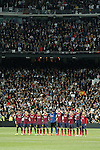 Barcelona´s players stand for a minutes silence as they remember former Spain Prime Minister Adolfo Suarez before La Liga match in Santiago Bernabeu stadium in Madrid, Spain. March 23, 2014. (ALTERPHOTOS/Victor Blanco)