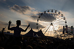 © Joel Goodman - 07973 332324 . 09/06/2013 . Heaton Park , Manchester , UK . Revellers in front of the main stage as the sun sets at the end of the weekend . Day 2 of the Parklife music festival in Manchester on Sunday 9th June 2013 . Photo credit : Joel Goodman