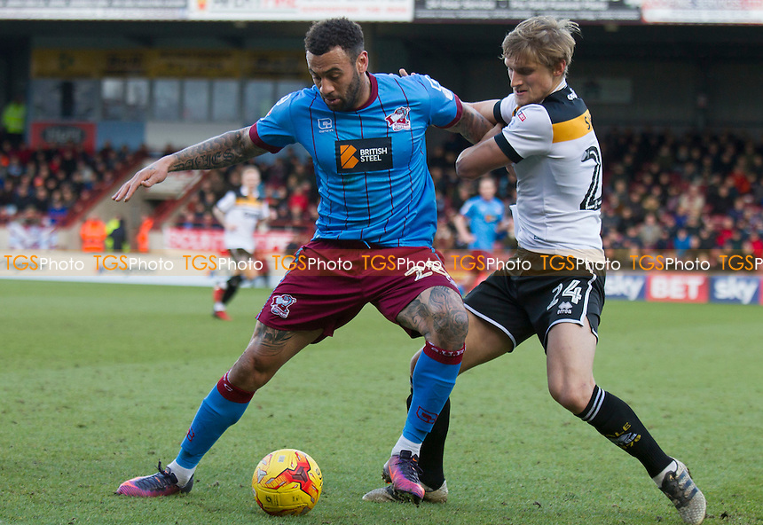Craig Davies (Scun Utd) and Nathan Smith of Port Vale during Scunthorpe United vs Port Vale, Sky Bet EFL League 1 Football at Glanford Park on 28th January 2017