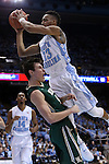 30 December 2014: North Carolina's J.P. Tokoto is fouled by William and Mary's Omar Prewitt (4). The University of North Carolina Tar Heels played the College of William & Mary Tribe in an NCAA Division I Men's basketball game at the Dean E. Smith Center in Chapel Hill, North Carolina. UNC won the game 86-64.