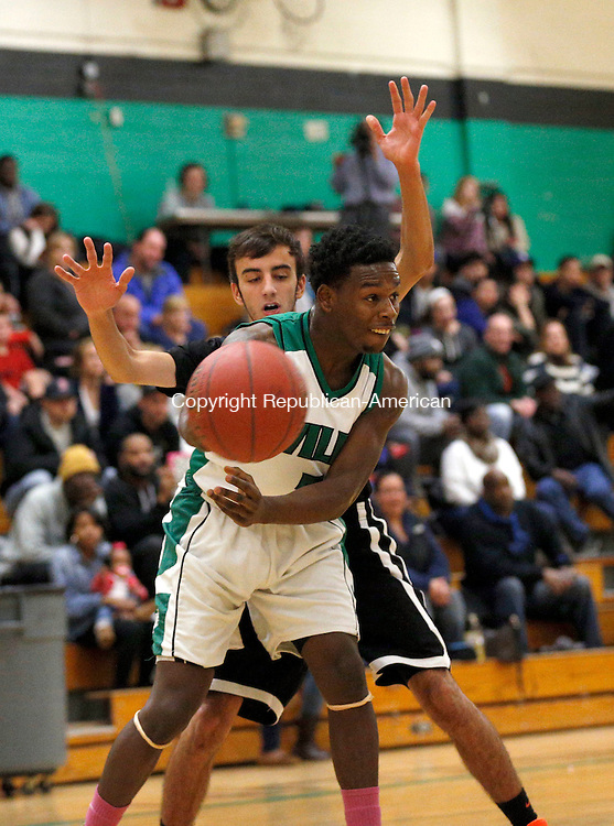 Waterbury, CT- 07 January 2016-010716CM04- Wilby's Darrien Bell passes the ball ahead of Watertown's Mike Vailonis during their NVL matchup in Waterbury on Thursday.     Christopher Massa Republican-American
