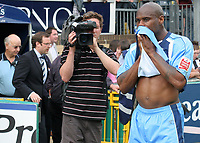 Frank Sinclair of Wycombe Wanderers, former Chelsea player, anxiously waits at the final whistle to hear the results from other games to see if Wycombe have won promotion during Wycombe Wanderers vs Notts County, Coca Cola League Division Two Football at Adams Park on 2nd May 2009