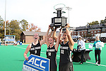 09 November 2014: Wake Forest captians Georgia Holland (9), Tyra Clemmenson (12), and Anna Kozniuk (CAN) (22) hold the ACC Championship Trophy overhead. The Wake Forest University Demon Deacons played the Syracuse University Orange at Jack Katz Stadium in Durham, North Carolina in the 2014 Atlantic Coast Conference NCAA Division I Field Hockey Championship Game. Wake Forest won the ACC Championship game 2-0.