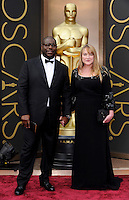 HOLLYWOOD, CA - MARCH 2: Steve McQueen, Bianca Stigter arriving to the 2014 Oscars at the Hollywood and Highland Center in Hollywood, California. March 2, 2014. Credit: SP1/Starlitepics. /NORTePHOTO