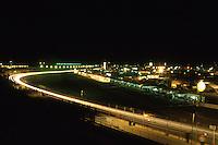 DAYTONA BEACH, FL - FEBRUARY 1: A time-exposure photo illustrating streaks of headlights as cars drive through the tri-oval during the 1987 24 Hours of Daytona at the Daytona International Speedway in Daytona Beach, Florida, on February 1, 1987.