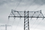 The abstract photograph of electricity pylons as a reflection in the water.