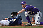 Aggie John Williams dives safely back under the tag of Huskies' Trevor Mitsui during a college baseball game between the Washington Huskies and the UC Davis Aggies, in Davis, Ca., on Saturday, Feb. 16, 2013. Davis won the opener 6-5, but lost the second game 3-2..Photo by Cathleen Allison