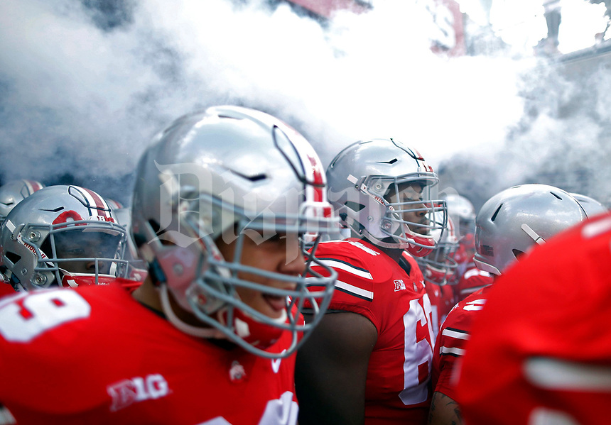 Ohio State Buckeyes offensive lineman Malcolm Pridgeon (66) and Ohio State Buckeyes offensive lineman Matthew Burrell (69) take the field before the start of their game against Maryland Terrapins at Ohio Stadium in Columbus, Ohio on October 7, 2017.  [Kyle Robertson/Dispatch]
