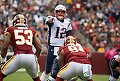 New England Patriots quarterback Tom Brady (12) calls signals in the first quarter against the Washington Redskins at FedEx Field in Landover, Maryland on Sunday, October 6, 2019.  Defending on the play are Washington Redskins inside linebacker Jon Bostic (53) and nose tackle Daron Payne (94).<br /> Credit: Ron Sachs / CNP