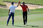 NORTH PLAINS, OR - AUGUST 23: Adam Hadwin of Canada celebrates with Kevin Kim after hitting his second shot from the fairway in for an eagle during third round of the WinCo Foods Portland Open presented by Kraft on August 23, 2014 in North Plains, Oregon. (Photo by Steve Dykes/Getty Images) *** Local Caption *** Adam Hadwin; Kevin Kim