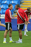 CARDIFF, WALES - SEPTEMBER 05: Team captain Ashley Williams (R) shares a joke with James Chester (L) during the Wales training session, ahead of the UEFA Euro 2016 qualifier against Israel, at the Cardiff City Stadium on September 5, 2015 in Cardiff, Wales.