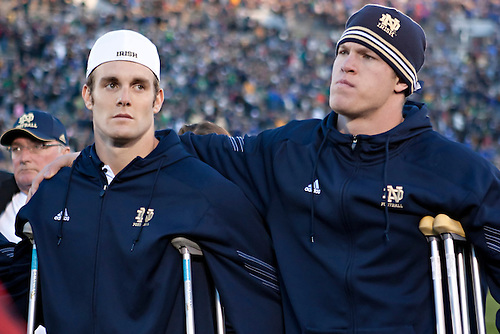 Notre Dame quarterback Dayne Crist (#10) and tight end Kyle Rudolph (#9) during alma mater Notre Dame Our Mother after game.  The Tulsa Golden Hurricane defeated the Notre Dame Fighting Irish 28-27 in game at Notre Dame Stadium in South Bend, Indiana.