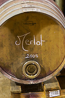 Merlot 2005. Chateau la Condamine Bertrand. Pezenas region. Languedoc. Barrel cellar. Barrel with special metal fitting for red wine barrel fermentation. France. Europe.