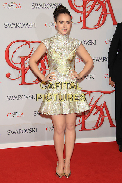 Lily Collins.The 2012 CFDA Fashion Awards held at Alice Tully Hall - Lincoln Center, New York, NY, USA..June 4th, 2012 .full length gold sleeveless dress hands on hips.CAP/LNC/TOM.©LNC/Capital Pictures.