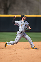 Kennesaw State Owls shortstop Kal Simmons (10) makes a throw during infield practice prior to the game against the Winthrop Eagles at the Winthrop Ballpark on March 15, 2015 in Rock Hill, South Carolina.  The Eagles defeated the Owls 11-4.  (Brian Westerholt/Four Seam Images)