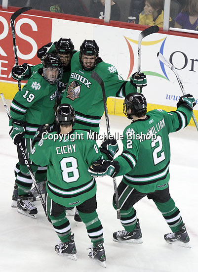 North Dakota celebrates Matt Frattin's goal in the third period. No. 8 North Dakota used a three-goal third period to beat No. 4 UNO 6-5 Friday night at Qwest Center Omaha. (Photo by Michelle Bishop)